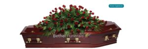 Rose signature flowers on coffin