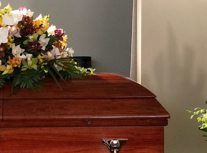 Casket with floral arrangements