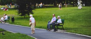 seniors sitting on a bench in a park