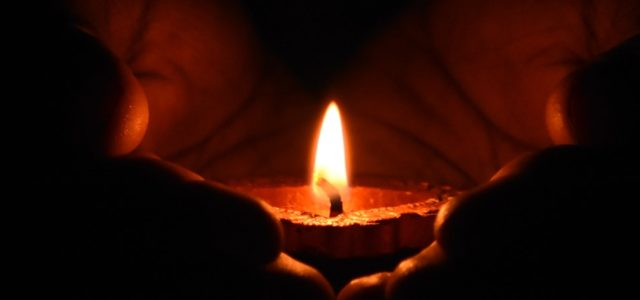 tea light candle being held